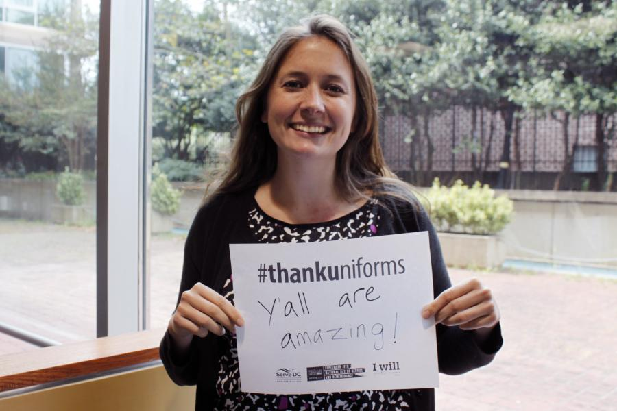 Serve DC staff member with custom #ThankUniforms sign